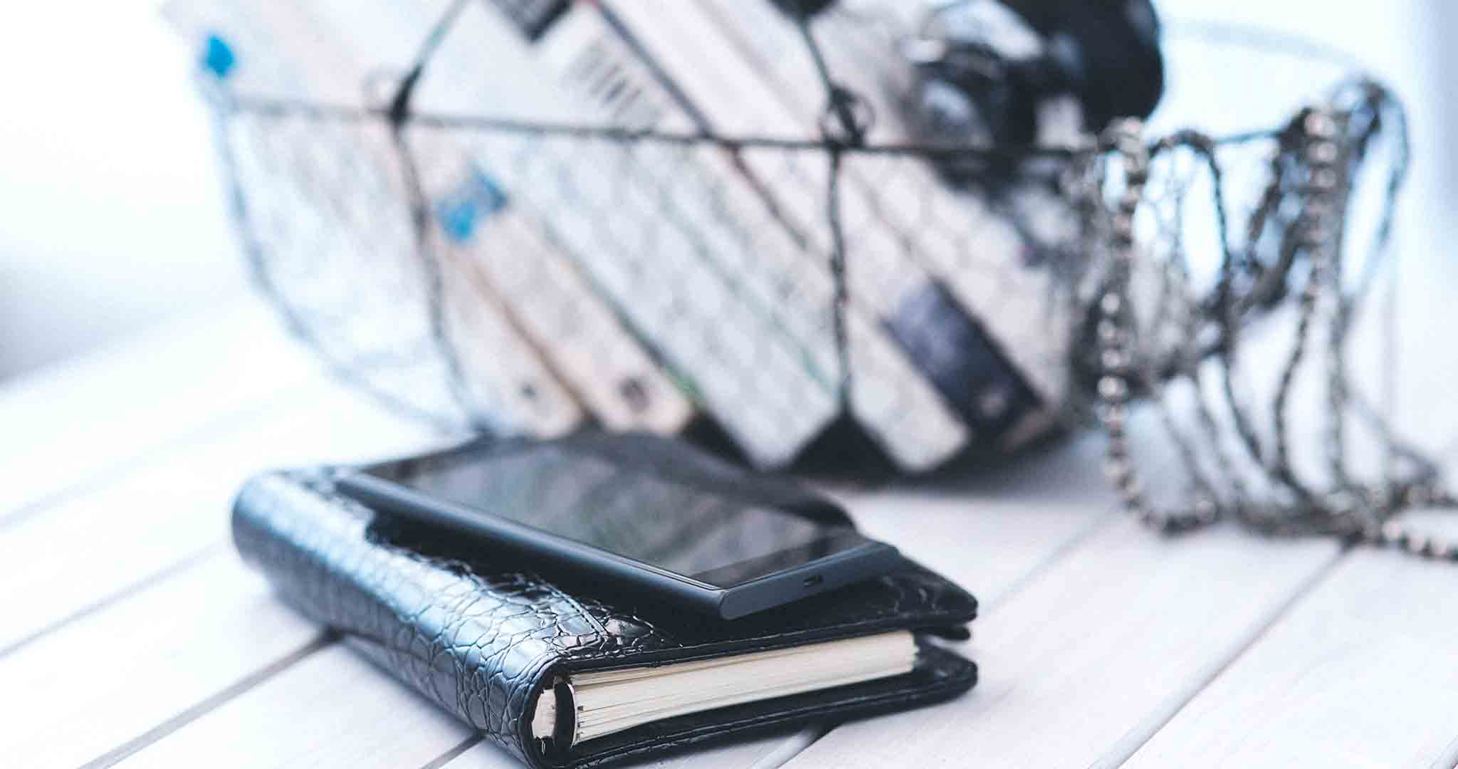 books contacts smartphone book stock photos