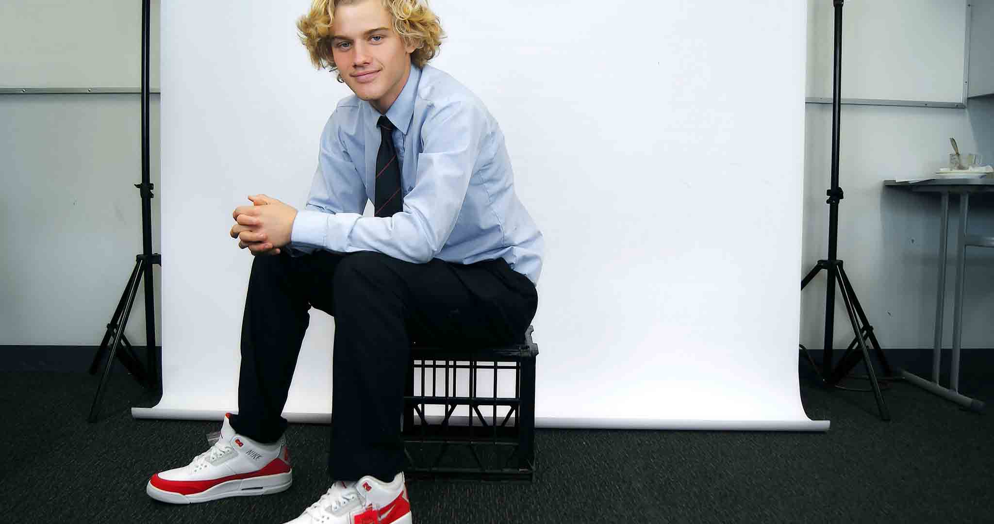 adolescent air jordan blonde business man stock photography