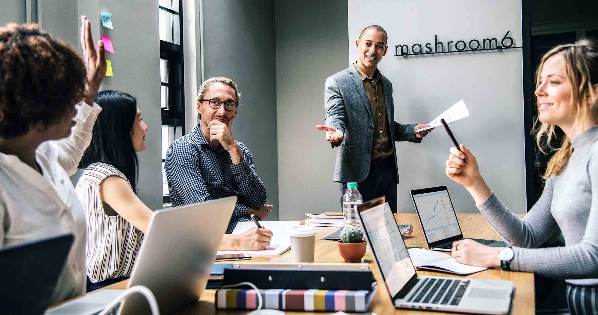 colleagues digital device discussion presentation stock photography